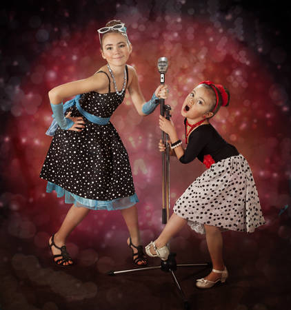 Rockabilly girls singing on a colorful background with glowing lights photo