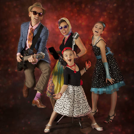 square dancing: Rock musician family have fun playing music and singing on a black background with glowing lights