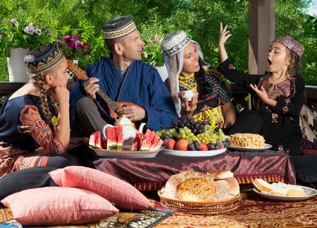 mandolin: Uzbek family has fun playing the mandolin and dancing during breakfast