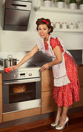 emulation: Housewife doing housework in a kitchen. 1950s style post processing emulation.