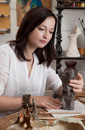 sculptor: Sculptor working with clay in a studio Stock Photo