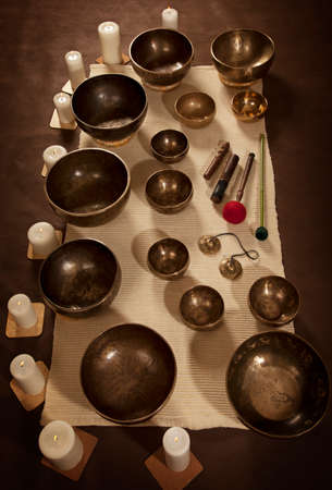 singing bowls: Set of Tibetan singing bowls with burning candles Stock Photo