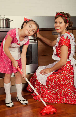 emulation: Retro styled mother with her daughter in a kitchen. Intentional 1950s style emulation.