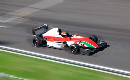 speed car: Motion blur of racing car on speed track