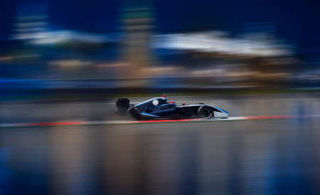 Motion blur of racing car on speed track