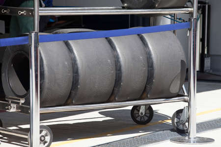 utilized: Wheels   are standing in row in the rack, close-up Stock Photo