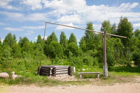 backwoods: Water well on the background of forest. Russian remote