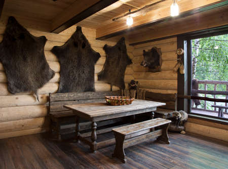 dead wood: The interior of the hunters house with the skins of wild boars hung on the walls