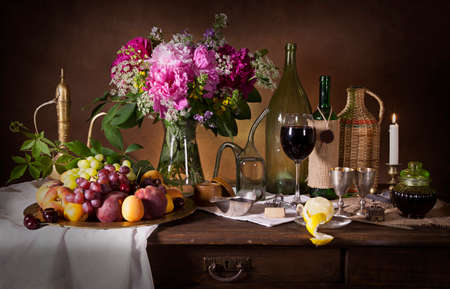 Dutch style still life with fruit, flowers and wine