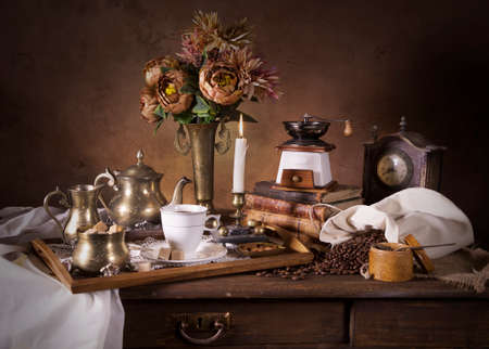 classical style: Classical Dutch style with fruit, flowers, candle and tea tray Stock Photo