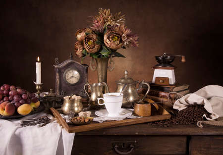 classical style: Still life with fruit, flowers, candle and tea tray in classical Dutch style Stock Photo