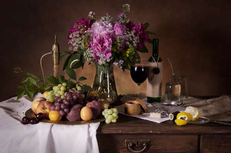 classical style: Still life with fruit, flowers and wine in classical Dutch style