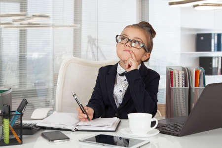 Adorable business girl (seven years old) working at the office Stock fotó - 66303193