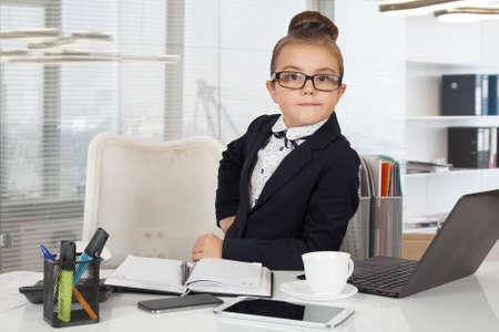 Little office worker, seven years old, working in office