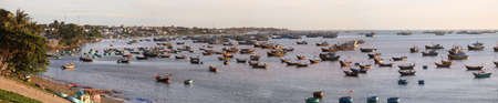 ne: Panoramic photo of the fishing village in the early morning at dawn. Mui Ne, Vietnam  Stock Photo