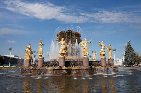 RUSSIA, MOSCOW - September  15, 2015: Exhibition of Achievements of the Peoples Economy (VDNKh). Famous fountain Friendship of peoples on territory of exhibition complex with the figures of girls of different nationality Stock Photo