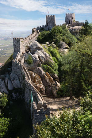 The Castle of the Moors is a hilltop medieval castle located in the municipality of Sintra, about 25km northwest of Lisbon, Portugal