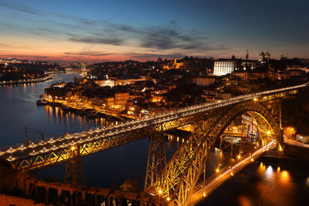luis: Panoramic view of night Porto with Douro river and Dom Luis I bridge, Portugal