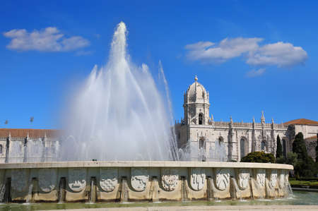 Fountain in Garden Praca do Imperio and Jeronimos Monastery in Lisbon. Portugal, Belem district.