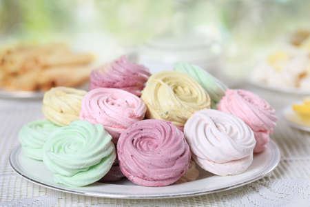 Delicate multicolored homemade zephyr or marshmallows on white openwork plate Stock Photo
