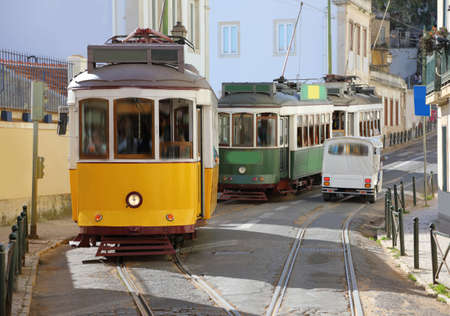 tramway: Traditional trams in the narrow streets of Lisbon in the district of Alfama, Portugal