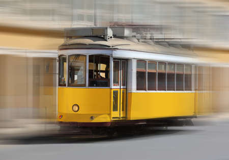 Traditional tram with motion blur on the background of the Lisbon city, Portugal