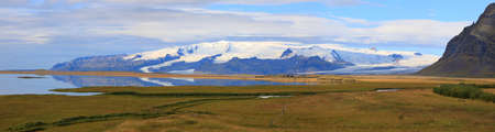 Panoramic view of the beautiful Icelandic landscape with a mountain covered with glaciers