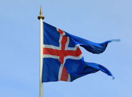 Iceland flag waving on the wind against a blue sky Stock Photo