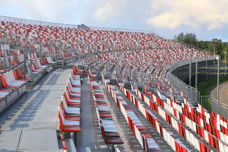 Empty grandstand sports facilities with colored plastic seats Stock Photo