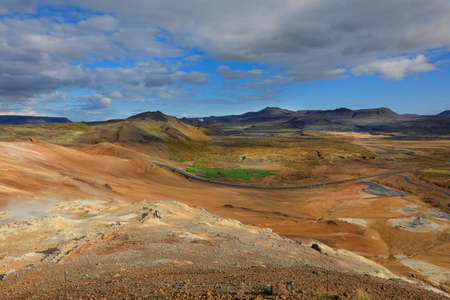 View of steaming fumaroles in geothermal valley Hverir Namafjall in north Iceland Stock Photo