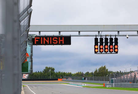 Finishing line with the finish on the electronic display and the red lights on the race track
