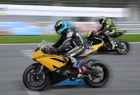 Motorcycle racers compete at high speed on the race track
