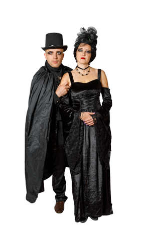 Portrait of a couple dressed in vampire style clothes isolated on white background