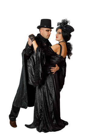 Cute couple dressed in vampire style clothes isolated on white background