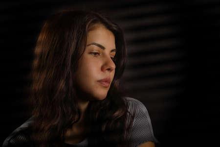 Portrait of a nice brunette girl on a black background Foto de archivo - 133715307