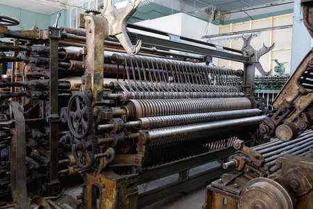 An old machine in the weaving shop at an abandoned textile factory