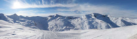 Panoramic view of the Alpine mountains in the bright rays of the sun in the ski resort of Livigno, Italy