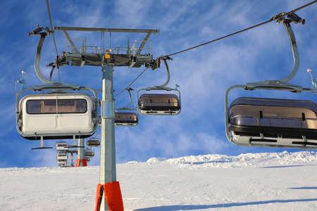 Ski lift against the blue sky in the ski resort of Livigno, Italy