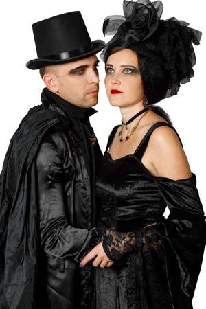 Portrait of a sweet couple dressed in old fashioned vampire style clothes isolated on a white background