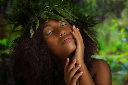 Sensual portrait of a beautiful young black woman on the nature background