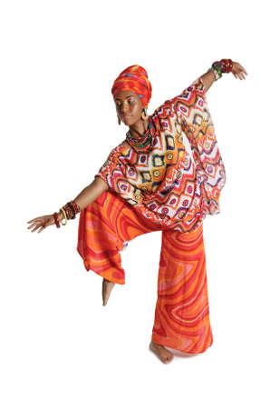 Cute African American woman in traditional clothes dancing in the studio, isolated on a white background