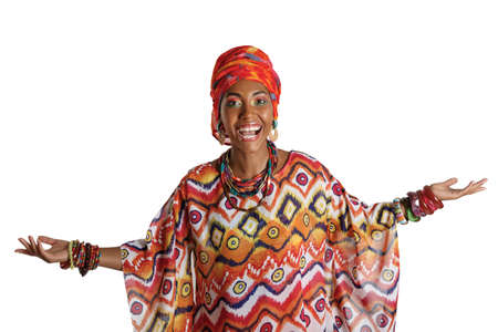 Young and attractive African American black woman in the national African dress isolated on a white background. Cosmetics, ethnicity. Foto de archivo