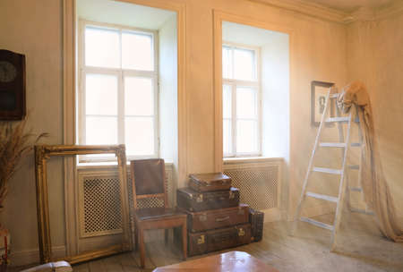 The interior of the living room is in a vintage style with large windows flooded with sunlight