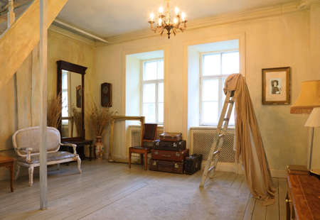 Interior of the living room is in a retro style with large windows flooded with sunlight