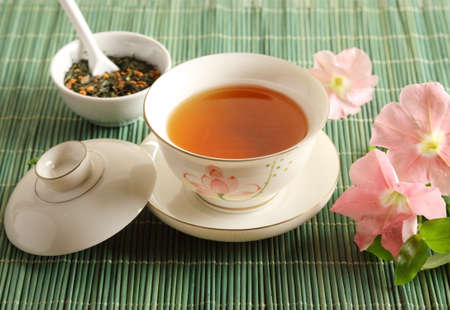 A cup of tea with flowers on the table