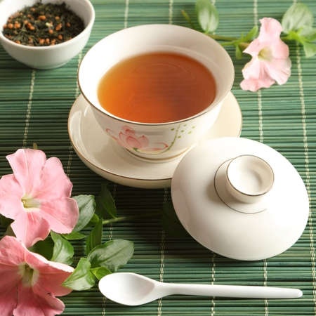 Cup of tea with flowers on the table