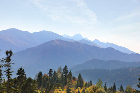 Mountain range in the blue haze of an early autumn morning. Caucasus mountains in Adygea, Russia
