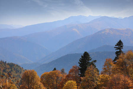 Amazing mountain range in the blue haze of an early autumn morning. Caucasus mountains in Adygea, Russia