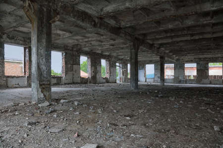Abandoned old broken industrial factory or warehouse building