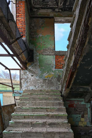 Staircase in an abandoned complex. Industrial background